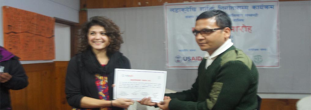 Ms. Amanda Cats-Baril, specialist at Democracy and Governance Department of USAID/Nepal providing certificate to a participant