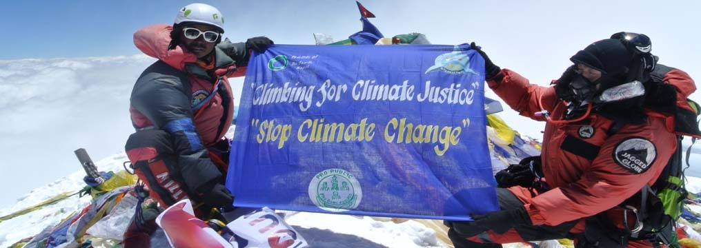 Pemba Dorje Sherpa and his team with banner of Pro Public demanding climate justice on the top of Everest