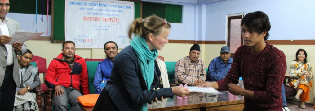 Maya Boehm, International Professional delivering certificate to a participant in  Basic Training on Mediation and Dialogue Facilitation in Hetauda organized by From Combatant to Peace Makers Program/ funded by USAID