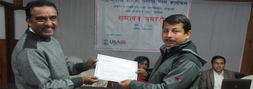 Senior Advocate Prakash Mani Sharma, Executive Director of Pro Public providing certificate to a participant